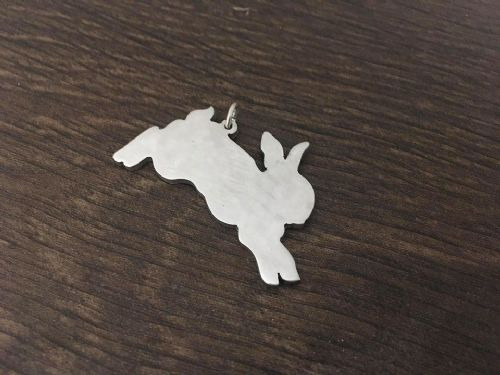 Bunny rabbit jumping pendant sterling silver handmade by saw piercing Caroline Howlett Design